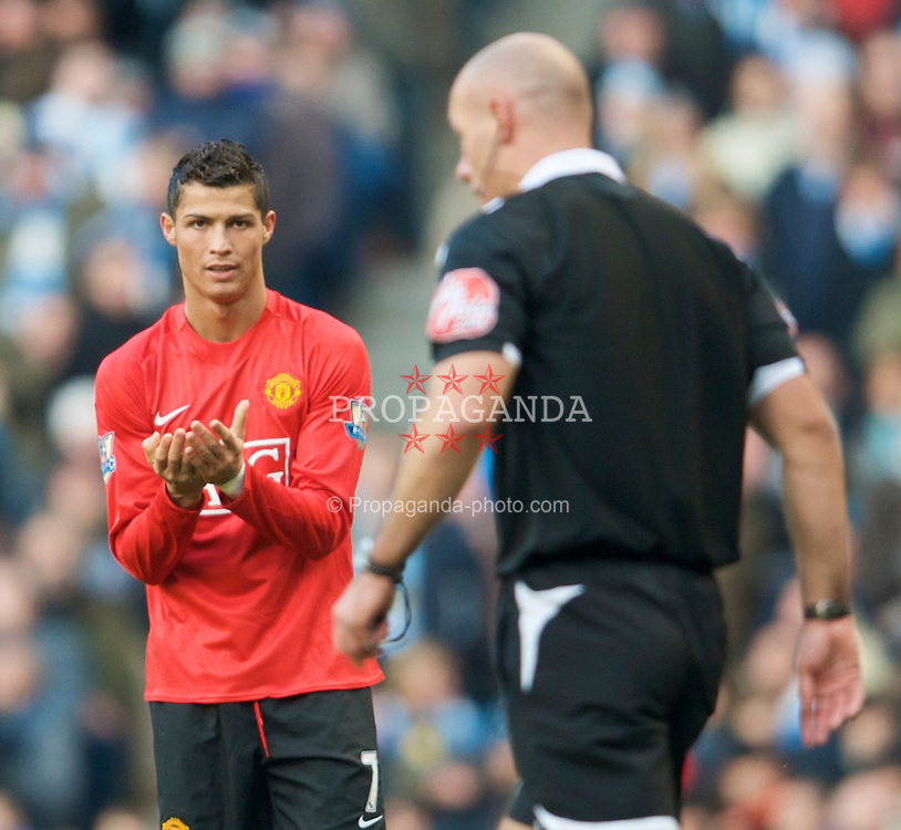 MANCHESTER, ENGLAND - Sunday, November 30, 2008: Manchester United's Christian Ronaldo disputes referee Howard Webb's yellow card during the Premiership match against Manchester City at the City of Manchester Stadium. (Photo by David Rawcliffe/Propaganda)