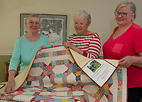"Ardythe Eaton, Diane Maher and Camille Hron with the 1930's themed raffle quilt they made for the upcoming 100th Gilford Old Home Day themed ""A Century of Old Fashioned Family Fun"".   (not pictured is Priscilla Selfridge)  (Karen Bobotas/for the Laconia Daily Sun)"