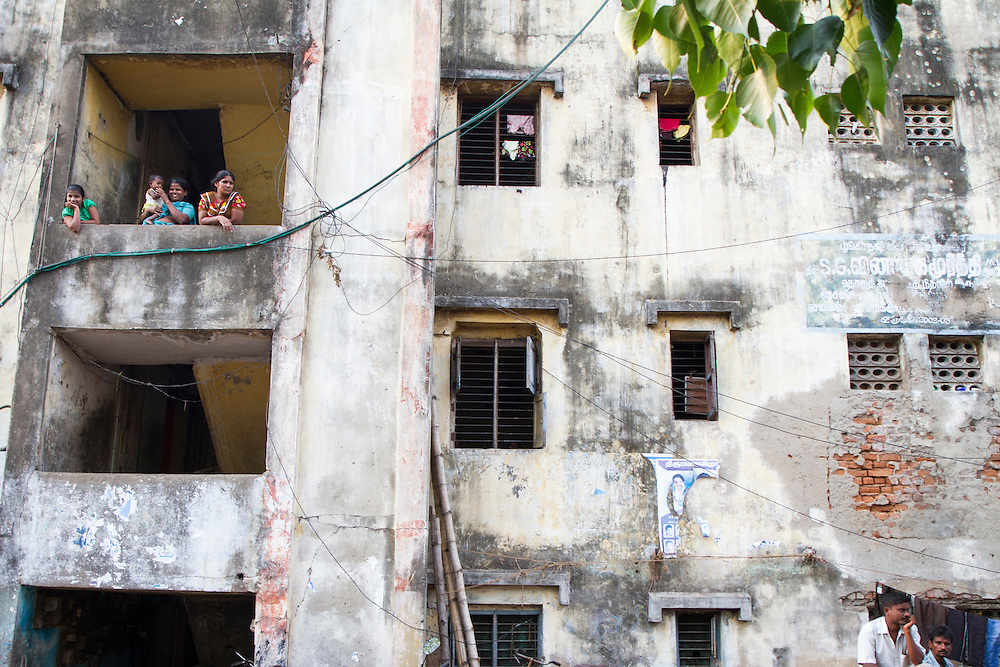 A government constructed building houses many families in a slum in Chennai, India.  The buildings were made as temporary structures to help ease homelessness, but many occupants say the homes aren't well made.