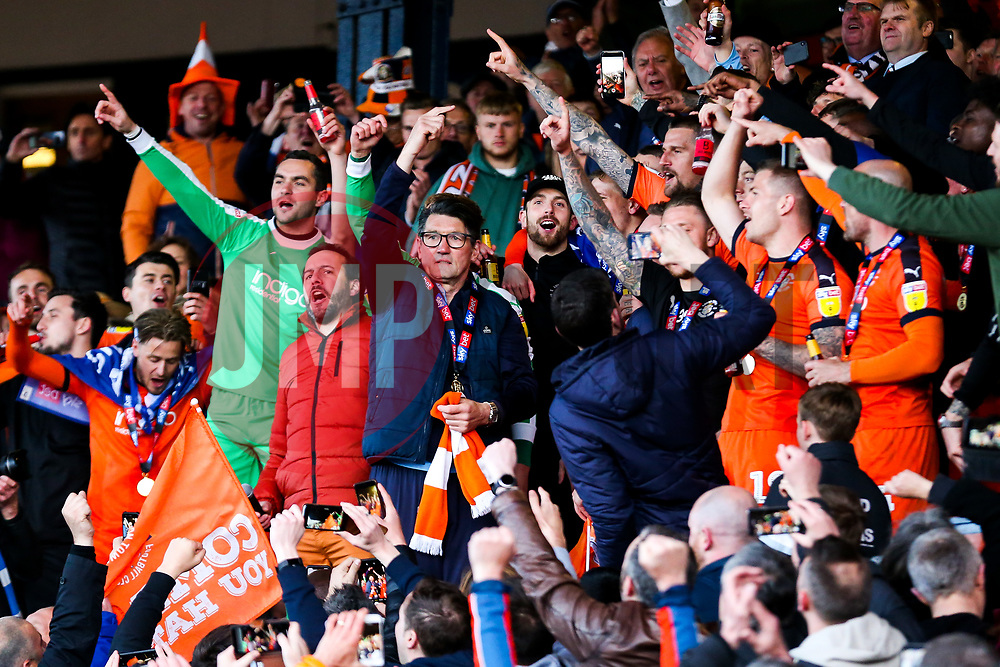Luton Town manager Mick Harford celebrates in the director's box as Luton Town celebrate winning the league and securing automatic promotion from Sky Bet League 1 to the Sky Bet Championship - Rogan/JMP - 04/05/2019 - Kenilworth Road - Luton, England - Luton Town v Oxford United - Sky Bet League One.