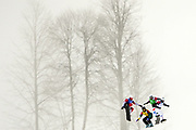 Australia's Cameron Bolton (centre) leads Tim Watter of Switzerland (right), Canada's Robert Fagan (left) and Luca Motteotti of Italy in his Men's Snowboard Cross 1/8 Final in the XXII Olympic Winter Games at Extreme Park in Sochi, Russia.