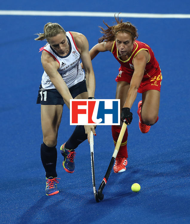 RIO DE JANEIRO, BRAZIL - AUGUST 15:  Kate Richardson-Walsh (L) of Great Britain is challenged by Begona Garcia during the Women's quarter final hockey match between Great Britain and Spain on Day10 of the Rio 2016 Olympic Games held at the Olympic Hockey Centre on August 15, 2016 in Rio de Janeiro, Brazil.  (Photo by David Rogers/Getty Images)