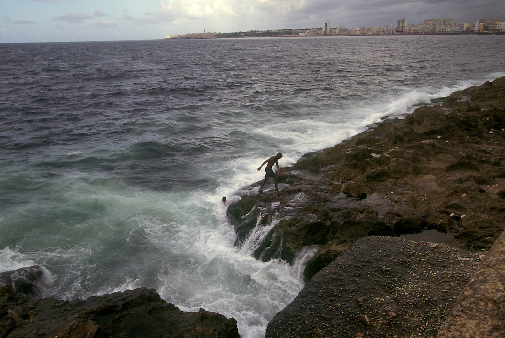 Swimmers dive into the Caribbean from the the Malecon, Havana's curved promenade.
