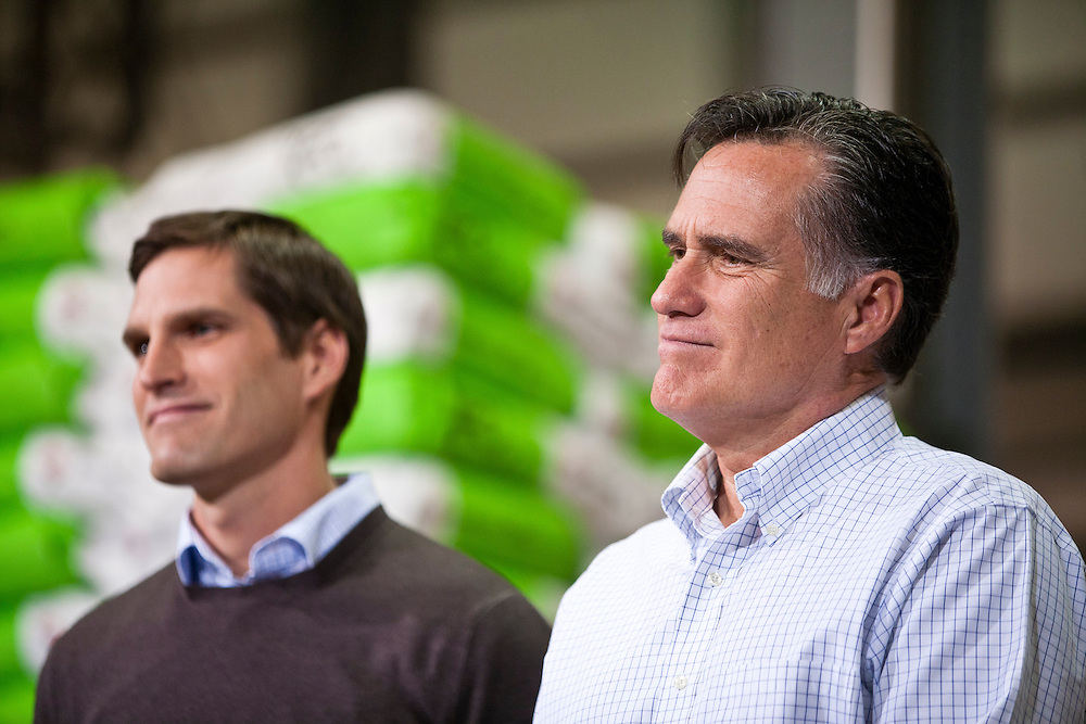 Republican presidential candidate Mitt Romney, right, and his son Josh Romney, listen at a town hall meeting at the Diamond V South Plant on Friday, December 9, 2011 in Cedar Rapids, IA.