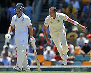 Peter Siddle follows through while bowling from the Vulture Street end on Day 2 of the 1st Test in the 2013-14 Ashes Cricket Series between Australia and England at the GABBA (Brisbane, Australia) from Thursday 21st November 2013<br /> <br /> Conditions of Use : NO AGENTS ~ This image is subject to copyright and use conditions stipulated by Cricket Australia.  This image is intended for Editorial use only (news or commentary, print or electronic) - Required Image Credit : &quot;Steven Hight - AURA Images&quot;