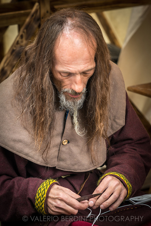 Cutting wicks to make candles. It's been 950 years since King Harold got an arrow in the eye at the Battle of Hastings. A group of re-enactors set up a camp near Apsley House in Hyde Park, London, to show their weapons, games and living arrangements.