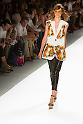 Shiny black pants and print top. By Custo Barcelona at the Spring 2013 Fashion Week show in New York.