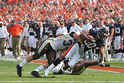 Virginia wide receiver Kevin Ogletree (20) is tackled by Wyoming linebacker Sean Claffey (34).  The Virginia Cavaliers defeated the Wyoming Broncos 13-12 in overtime on September 9, 2006 at Scott Stadium in Charlottesville, VA.