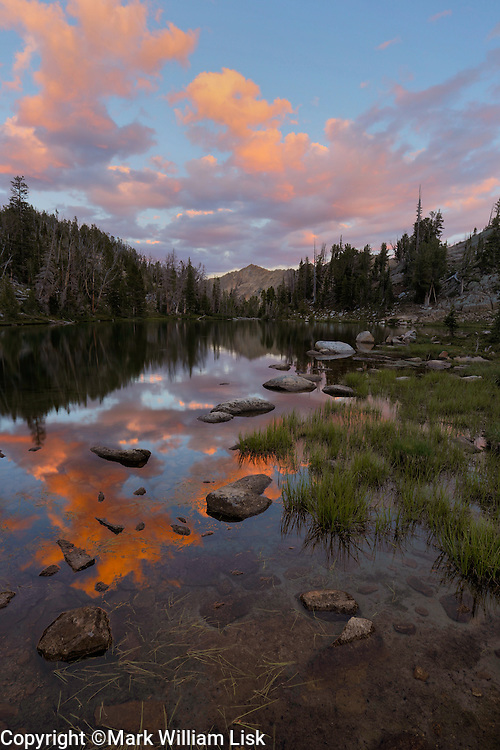 Un-named peaks reflects on the smooth surface of Hourglass Lake in the White Cloud Wilderness, Idaho.