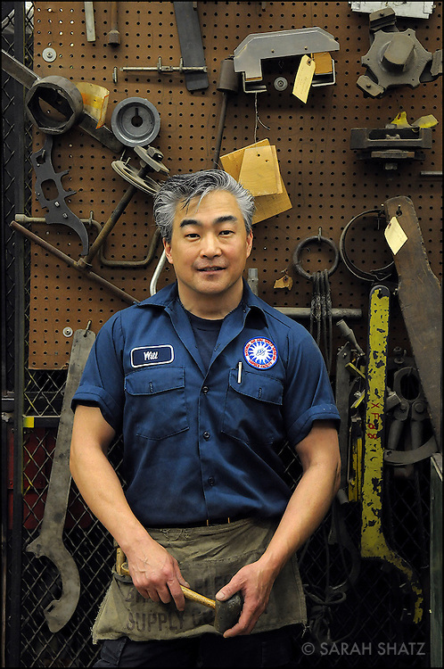Wilbert Lee, aircraft restorationist, at the Smithsonian Museum's Garber Preservation Facility