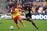 FOOTBALL - FRENCH CHAMPIONSHIP 2010/2011 - L1 - RC LENS v STADE RENNAIS - 17/10/2010 - PHOTO ERIC BRETAGNON / DPPI - ABDOUL CAMARA (RENNES) / SERGE AURIER (RCL)