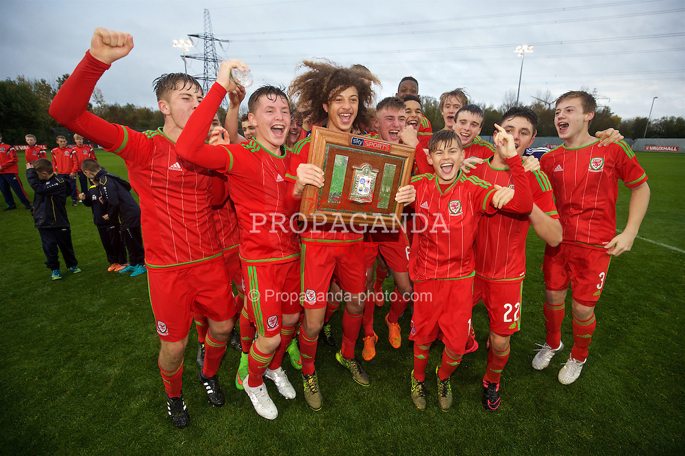 NEWPORT, WALES - Thursday, November 5, 2015: Wales' captain Ethan Ampadu leads the celebrations retaining the Victory Shield following a 3-1 victory over Northern Ireland during the Under-16's Victory Shield International match at Dragon Park. Kieron Holsgrove, Brandon Cooper, Elliot Thorpe. (Pic by David Rawcliffe/Propaganda)