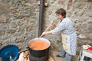Valentina Donevski making ajvar in Kratovo, Macedonia. Ajvar is a tradional sauce made in Macedonia and other countries in the Balkans, served as an accompaniment with meat, cheese and other dishes. Made from roasted peppers, aubergines and other vegetables, and cooked for several hours in a large pot, it is usually prepared in September/October. © Rudolf Abraham