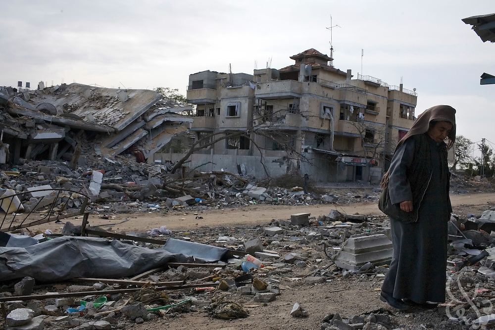 A Palestinian man walks through rubble of homes destroyed during continuing bombing by the Israeli Air Force along the Philadelphi corridor in Rafah Gaza January 16, 2009. The Israeli Defense Forces claim their sustained campaign has significantly degraded smuggling tunnels along  the corridor and the damaged the ability of HAMAS to smuggle weapons and cash into the Strip.