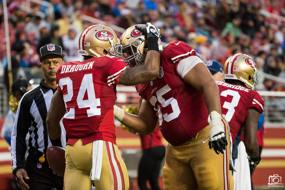 San Francisco 49ers running back Shaun Draughn (24) celebrates a touchdown against the New England Patriots at Levi's Stadium in Santa Clara, Calif., on November 20, 2016. (Stan Olszewski/Special to S.F. Examiner)