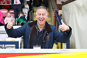 AFC Wimbledon fan with thumbs up during the The FA Cup match between AFC Wimbledon and Lincoln City at the Cherry Red Records Stadium, Kingston, England on 4 November 2017. Photo by Matthew Redman.