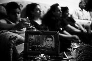 Portrait of a son. Family members of Medo mourn his loss. Nag Hamadi, Egypt.