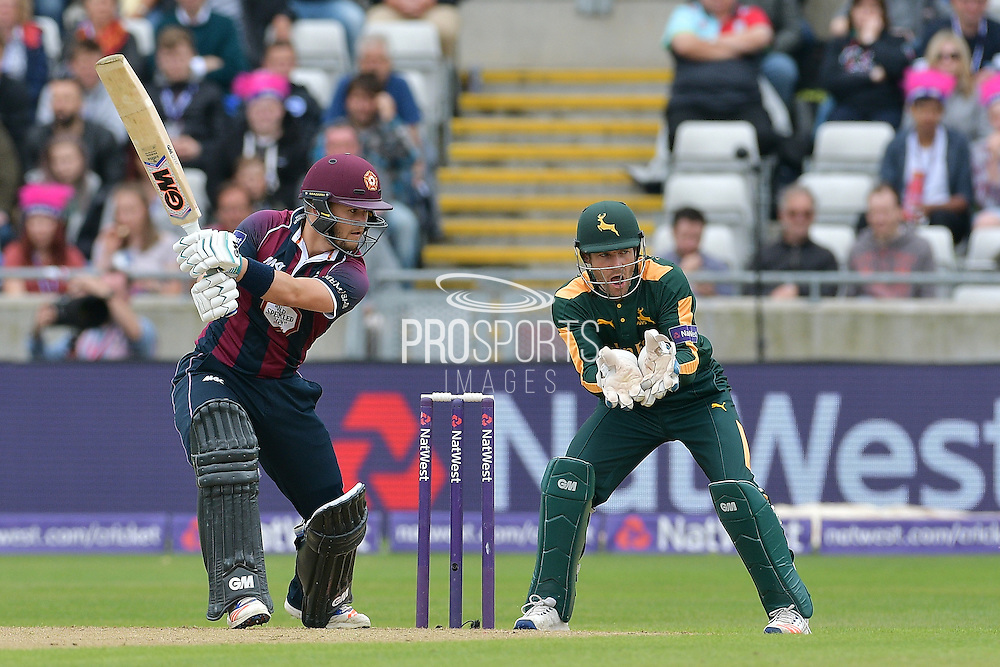 Ben Duckett square drives Steven Mullaney (not shown) watched on by Chris Read  during the NatWest T20 Finals Day 2016 match between Nottinghamshire County Cricket Club and Northamptonshire County Cricket Club at Edgbaston, Birmingham, United Kingdom on 20 August 2016. Photo by Simon Trafford.