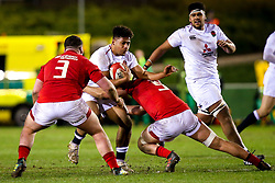 Samson Ma'asi of England U20 is tackled - Mandatory by-line: Robbie Stephenson/JMP - 22/02/2019 - RUGBY - Zip World Stadium - Colwyn Bay, Wales - Wales U20 v England U20 - Under-20 Six Nations