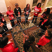 Members of Mu Pi Chapter of play a game called the Web game, during a celebration to honor the very first chapter line at the University of Delaware Saturday, Nov. 07, 2015 at Christiana Hilton in Newark.