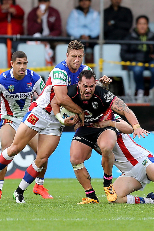 Tariq Sims of the Newcastle Knights tackles Bodene Thompson of the New Zealand Warriors during their round 12 NRL match at Mount Smart Stadium, Auckland on  Sunday, May 31, 2015. Credit: SNPA / David Rowland
