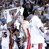 21 June 2012: Miami Heat point guard Mario Chalmers (15), Miami Heat small forward Shane Battier (31) and Miami Heat power forward Chris Bosh (1) celebrate after the Miami Heat 121-106 victory over the Oklahoma City Thunder, in Game 5 of the 2012 NBA Finals, at the AmericanAirlinesArena, Miami, Florida, USA. The Miami Heat wins the series 4-1.