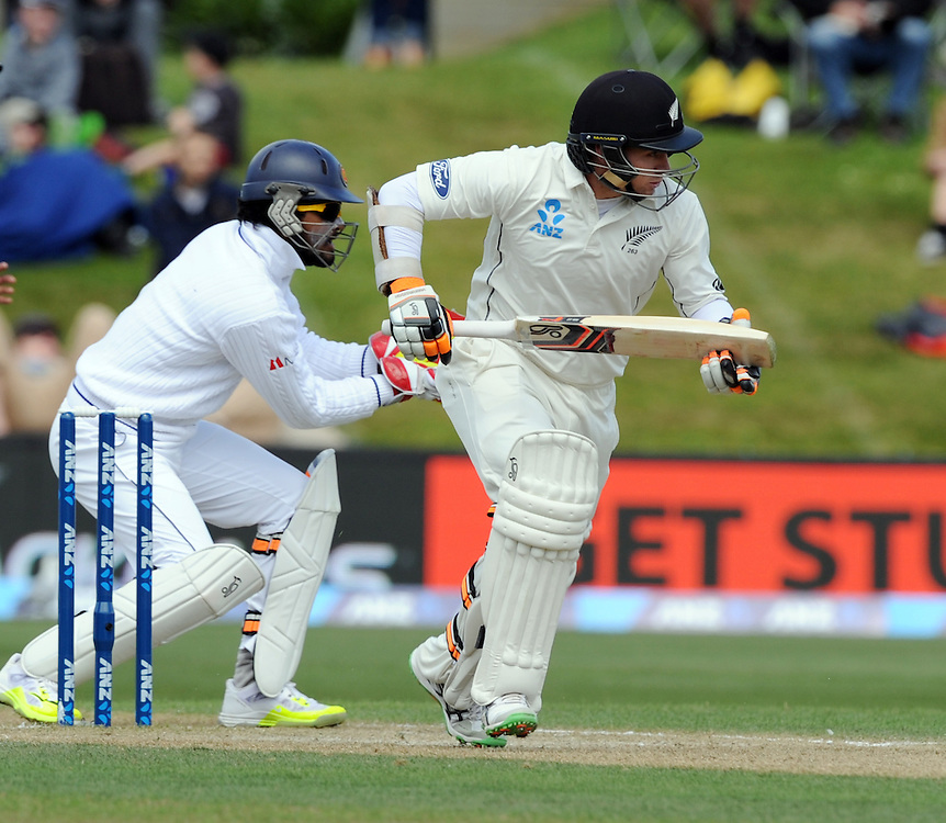 New Zealand's Tom Latham takes a run in front of Sri Lanka's Dinesh Chandimal on day four of the first International Cricket Test, University Cricket Oval, Dunedin, New Zealand, Sunday, December 13, 2015. Credit:SNPA / Ross Setford