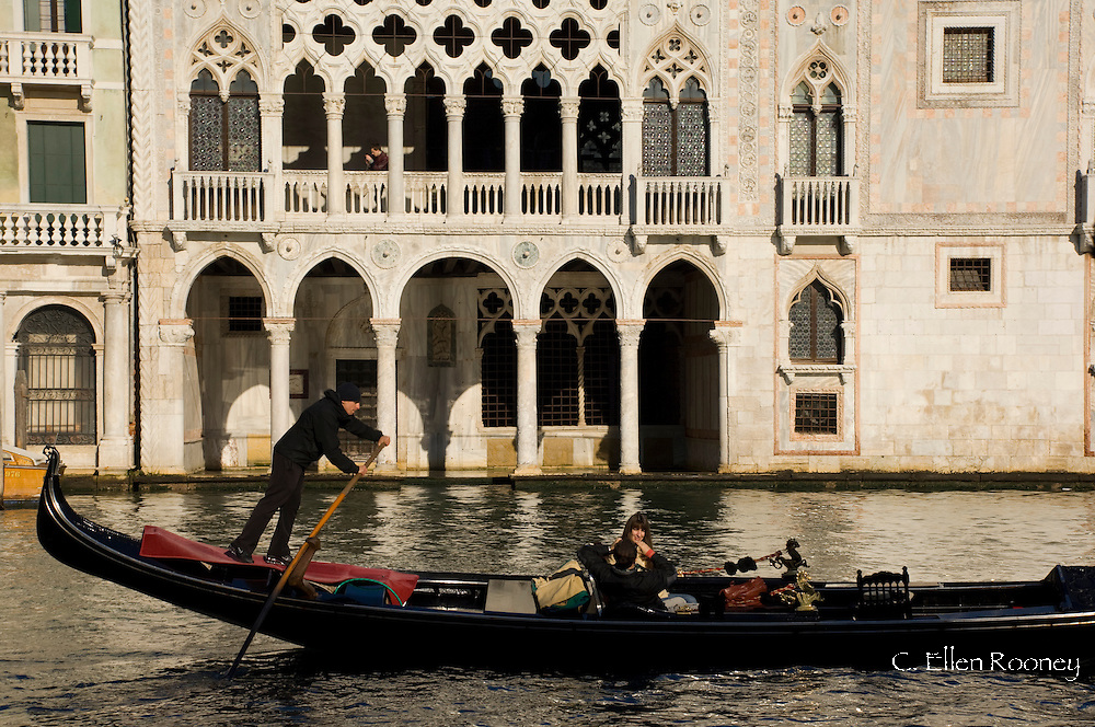 A gondola in front of the Palazzo Ca D'Oro on The Grand Canal;  Venice, Italy