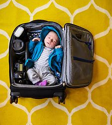 Baby Boy Sleeping inside Camera Bag
