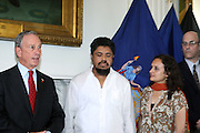 26 August 2010- New York, NY- l to r: City Council President Christine Quinn, Mayor Michael Bloomberg,  Taxi Driver Ahmed Sharif, victim of anti-muslim bias attack, meets with Mayor Michael Bloomberg and New York City Council President Christine Quinn to denouce hate crimes in New York City. ..Taxi Cab Driver Ahmed Sharif was slashed and stabbed by a passenger who first asked if he were musilim, and then savegely stabbed him 5 times over  his face, throat and arrms by 21year-old Michael Enright, a College Student at School of Visual Arts who had just returned from Afghanistan.