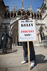 © Licensed to London News Pictures. 18/07/2013. London, UK. 10 years after his death, gagged protesters carry out a silent vigil as they call for a coroners report into the death of Doctor David Kelly in London today (18/07/2013). Dr Kelly, who was a Ministry of Defence weapons expert, was found dead in 2003 after being named as the source of quotations used by BBC journalist Andrew Gilligan in reports claiming that the Labour government of the time exaggerated the Iraqi weapons of mass destruction capability during the lead up to the 2003 invasion. Photo credit: Matt Cetti-Roberts/LNP