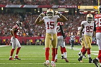 20 January 2013: Wide receiver (15) Michael Crabtree of the San Francisco 49ers catches a pass, runs, and celebrates against the Atlanta Falcons during the second half of the 49ers 28-24 victory over the Falcons in the NFC Championship Game at the Georgia Dome in Atlanta, GA.