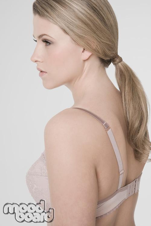 Sexy young woman wearing bra profile
