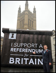 Conservative Party Chairman Grant Shapps poses for a photograph in front of a Ballot box with a I Support A  Referendum for Britain slogan on it in Westminster, London, United Kingdom. Wednesday, 6th November 2013. Picture by Andrew Parsons / i-Images