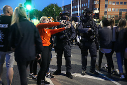 Concert-goers take a selfie next to armed police as they depart following the One Love Manchester benefit concert for the victims of the Manchester Arena terror attack at Emirates Old Trafford, Greater Manchester.
