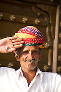 A doorman dressed in a colourful turban at a hotel in Pushkar, Rajasthan, India