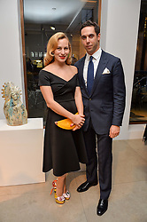 CHARLOTTE DELLAL and her husband MAXIM CREWE at a private view of Bright Young Things held at the David Gill Gallery, 2-4 King Street, London on 19th April 2016.