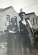 elderly couple in the backyard of there house England