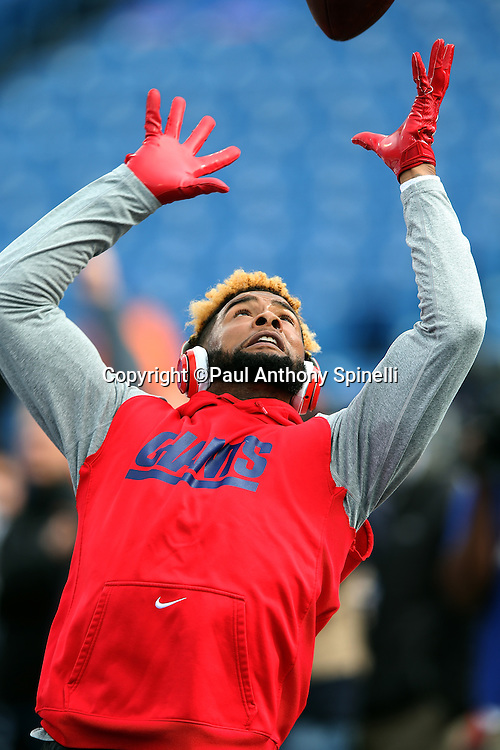 New York Giants wide receiver Odell Beckham Jr. (13) catches a pass while warming up before the 2015 NFL week 4 regular season football game against the Buffalo Bills on Sunday, Oct. 4, 2015 in Orchard Park, N.Y. (©Paul Anthony Spinelli)
