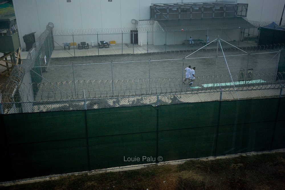 Detainees on a morning run in a recently constructed recreation yard in Camp 6 at the Guantanamo Bay Detention Facility in Guantanamo Bay, Cuba. The detainees held in this facility were captured after the attacks on the United States on September 11, 2001. In 2009 US president Barack Obama ordered the closure of the facility, yet to date it still remains open. These Photos were reviewed by military officials before release.