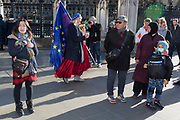 Two days before Brexit Day (the date of 31st January 2020, when the UK legally exits the European Union), a Remain protester mingles with tourists outside the British Parliament as Ministers arrive for the weekly Prime Minister's Questions session, in Parliament Square, Westminster, on 29th January 2020, in London, England.