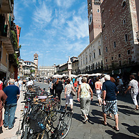 Piazza delle Erbe and market with stalls in Verona.Verona is a city in Veneton, Northern Italy home to approx. 265,000 inhabitants and one of the seven provincial capitals of the region. Verona has Roman origins and  derived importance from being at the intersection of many roads. It is world famous for the Arena and its Opera....***Agreed Fee's Apply To All Image Use***.Marco Secchi /Xianpix. tel +44 (0) 207 1939846. e-mail ms@msecchi.com .www.marcosecchi.com