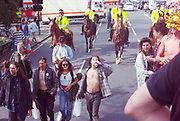 Mounted Police following rave protestors at the First Criminal Justice March.London.1st of May 1994.