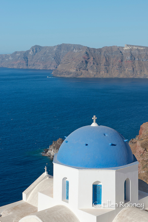Blue domed churches on a cliff overlooking the caldera in Oia, Santorini, The Cyclades, The Aegean, The Greek Islands, Greece, Europe