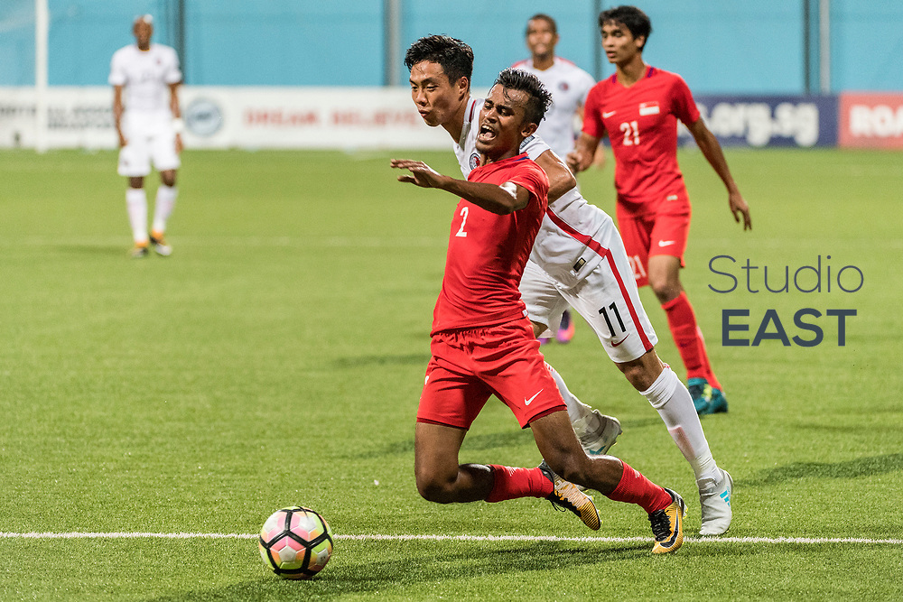 SINGAPORE, SINGAPORE - AUGUST 31: Lo Kong Wai of Hong Kong (foreground, right) fouls Shakir Hamzah of Singapore (foreground, left) to concede a penalty during the international friendly match between Singapore and Hong Kong at the Jalan Besar Stadium on August 31, 2017, in Singapore, Singapore. (Photo by Getty Images)
