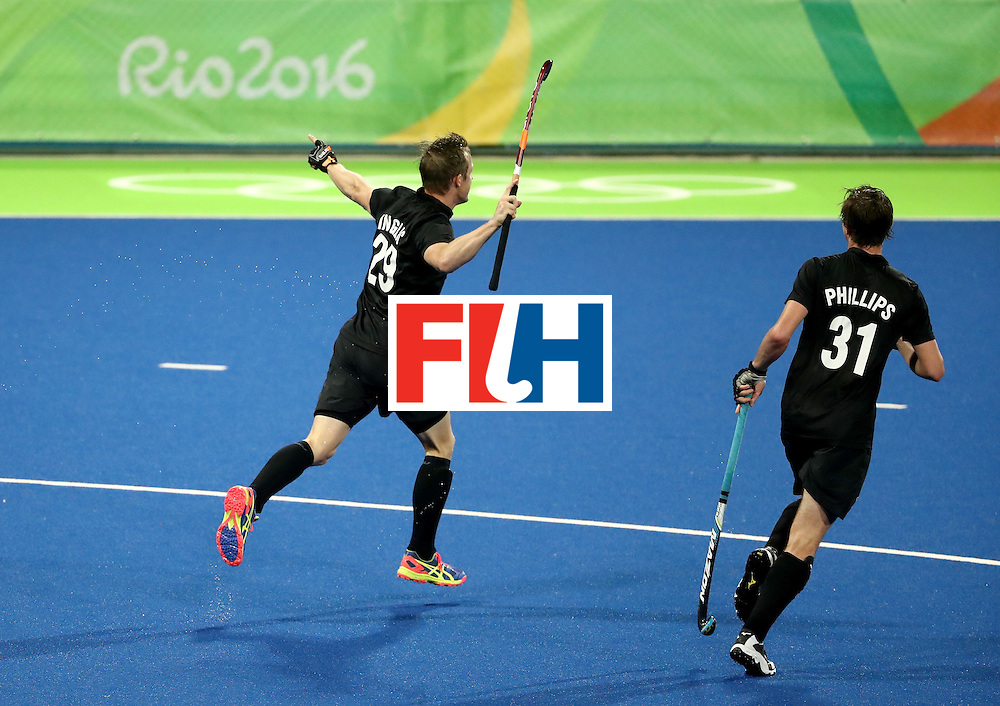 RIO DE JANEIRO, BRAZIL - AUGUST 12:  Hugo Inglis #29 and Hayden Phillips #31 of New Zealand react to a goal against Belgium uring a Men's Preliminary Pool B match on Day 7 of the Rio 2016 Olympic Games at the Olympic Hockey Centre on August 12, 2016 in Rio de Janeiro, Brazil.  (Photo by Sean M. Haffey/Getty Images)