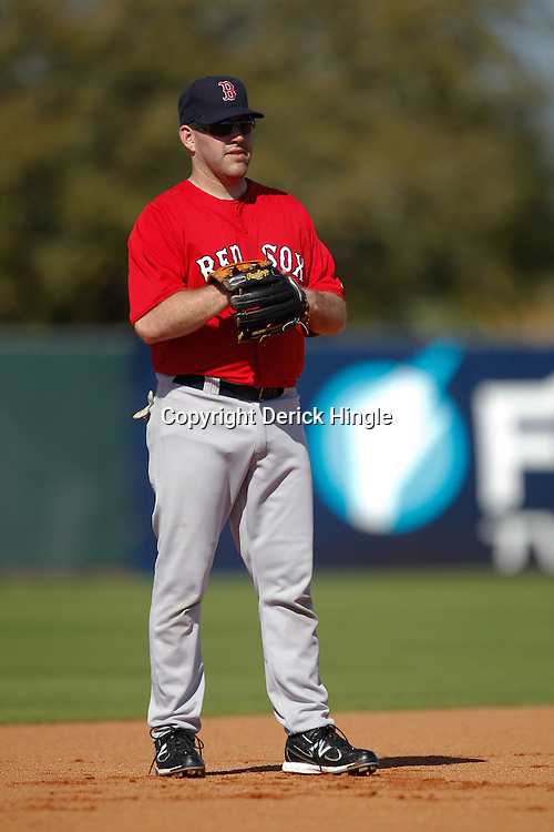February 19, 2011; Fort Myers, FL, USA; Boston Red Sox third baseman Kevin Youkilis (20) during spring training at the Player Development Complex.  Mandatory Credit: Derick E. Hingle