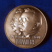 August (1862-1954) and Louis (1864-1948) Lumiere  French chemists and pioneers of cinematography. Obverse of medal commemorating 50 years of cinematography (1895-1945).