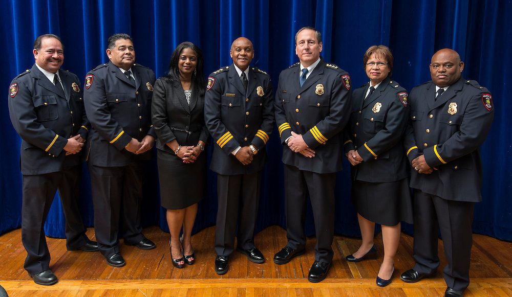 Members of the Houston ISD Police Department command staff pose for a photograph before the swearing-in ceremony for Chief of Police Robert Mock, January 6, 2014, at the High School for Law Enforcement and Criminal Justice.