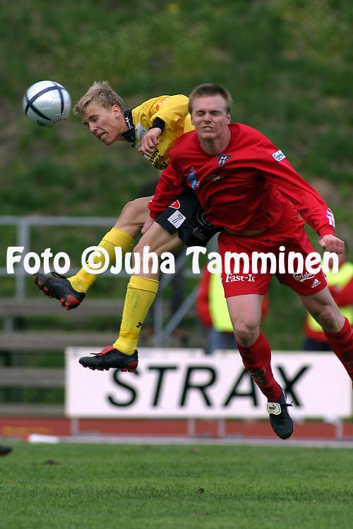 15.05.2004, Vuosaari, Helsinki, Finland..I Divisioona 2004 / Finnish 1st Division 2004.FC Viikingit v Kuopion Palloseura.Kalle Parviainen (KuPS) v Teemu Kankkunen (Viikingit).©Juha Tamminen